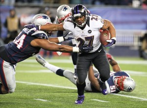 Jan 20, 2013; Foxboro, MA, USA; Baltimore Ravens running back Ray Rice (27) carries the ball as New England Patriots outside linebacker Dont