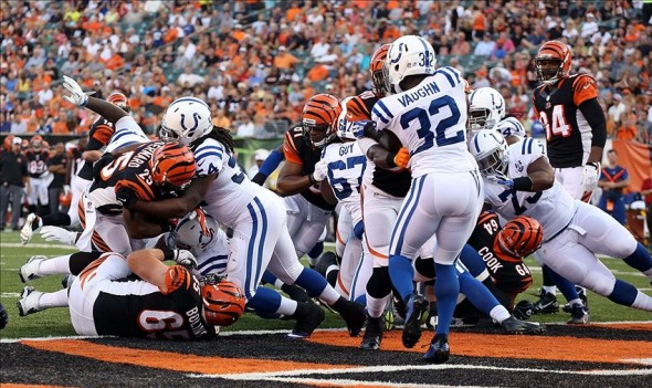 Aug 29, 2013; Cincinnati, OH, USA; Cincinnati Bengals running back Giovani Bernard (25) scores a touchdown as Indianapolis Colts linebacker Mario Harvery (54) tries to make a tackle at the goal line at Paul Brown Stadium. Mandatory Credit: Brian Spurlock-USA TODAY Sports