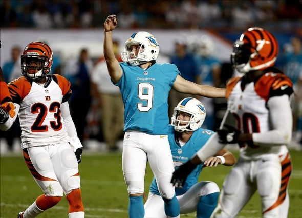 Oct 31, 2013; Miami Gardens, FL, USA; Miami Dolphins kicker Caleb Sturgis (9) kicks a field goal in the second quarter against the Cincinnati Bengals at Sun Life Stadium. Mandatory Credit: Robert Mayer-USA TODAY Sports