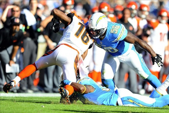 Dec 1, 2013; San Diego, CA, USA; San Diego Chargers linebacker Donald Butler (56) tackles Cincinnati Bengals wide receiver Andrew Hawkins (16) after a sweep play during the first half at Qualcomm Stadium. Mandatory Credit: Christopher Hanewinckel-USA TODAY Sports