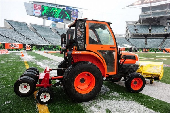 Dec 8, 2013; Cincinnati, OH, USA; A tractor removes snow from the field prior to the game between the Indianapolis Colts and Cincinnati Bengals at Paul Brown Stadium. Mandatory Credit: Andrew Weber-USA TODAY Sports