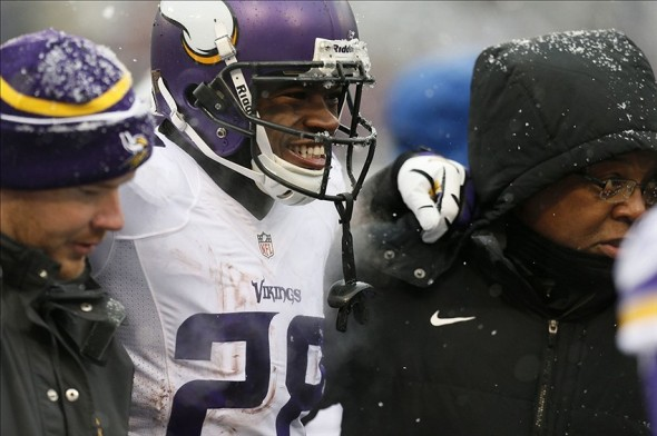 Dec 8, 2013; Baltimore, MD, USA; Minnesota Vikings running back Adrian Peterson (28) leaves the field with an apparent injury in the second quarter against the Baltimore Ravens at M