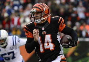 Dec 8, 2013; Cincinnati, OH, USA; Cincinnati Bengals quarterback Andy Dalton (14) runs the ball down field during the second half of the game at Paul Brown Stadium. Cincinnati Bengals beat Indianapolis Colts 42-28 Mandatory Credit: Marc Lebryk-USA TODAY Sports