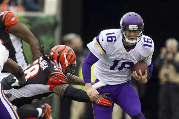 Dec 22, 2013; Cincinnati, OH, USA; Minnesota Vikings quarterback Matt Cassel (16) is tackled by Cincinnati Bengals middle linebacker Rey Maualuga (58) in the third quarter of the game at Paul Brown Stadium. Cincinnati Bengals beat the Minnesota Vikings by the score of 42-14. Mandatory Credit: Trevor Ruszkowksi-USA TODAY Sports
