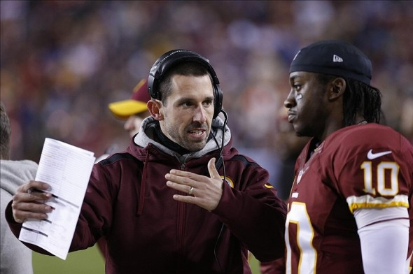 Dec 1, 2013; Landover, MD, USA; Washington Redskins offensive coordinator Kyle Shanahan talks with Redskins quarterback Robert Griffin III (10) on the sidelines against the New York Giants in the second quarter at FedEx Field. Mandatory Credit: Geoff Burke-USA TODAY Sports