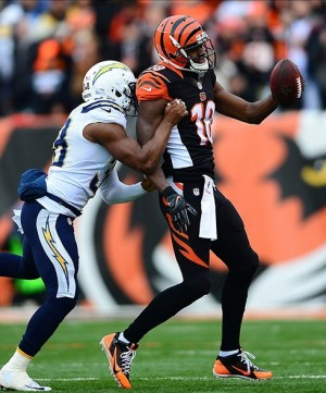 Jan 5, 2014; Cincinnati, OH, USA; San Diego Chargers strong safety Marcus Gilchrist (38) tackles Cincinnati Bengals wide receiver A.J. Green (18) after making a catch during second quarter of the AFC wild card playoff football game at Paul Brown Stadium. Mandatory Credit: Andrew Weber-USA TODAY Sports