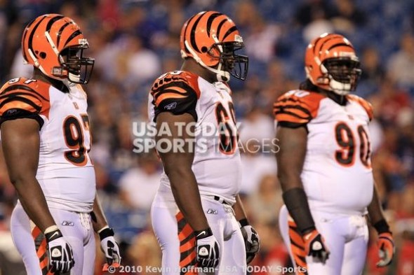 Aug 28, 2010; Orchard Park, NY, USA; Cincinnati Bengals defensive tackle Geno Atkins (97), defensive tackle Clinton McDonald (69) and defensive tackle Pat Sims (90) in action against the Buffalo Bills at Ralph Wilson Stadium. Mandatory Credit: Kevin Hoffman-USA TODAY Sports