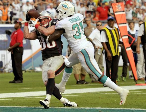Dec 15, 2013; Miami Gardens, FL, USA; New England Patriots wide receiver Danny Amendola (80) is defended by Miami Dolphins safety Michael Thomas (30) defends at Sun Life Stadium. Miami defeated New England 24-20. The catch was incomplete. Mandatory Credit: Brad Barr-USA TODAY Sports