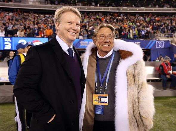 Feb 2, 2014; East Rutherford, NJ, USA; NFL former player Phil Simms (left) talks with former quarterback Joe Namath prior to Super Bowl XLVIII between the Denver Broncos and the Seattle Seahawks at MetLife Stadium. Mandatory Credit: Matthew Emmons-USA TODAY Sports