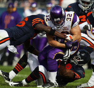 Vikings RB runs the ball against NFC North Rivals, the Chicago Bears. Full credit to www4.pictures.zimbio.com/