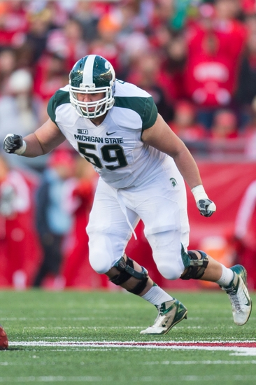 Oct 27, 2012; Madison, WI, USA; Michigan State Spartans offensive tackle Dan France (59) during the game against the Wisconsin Badgers at Camp Randall Stadium. Michigan State defeated Wisconsin 16-13. Mandatory Credit: Jeff Hanisch-USA TODAY Sports