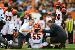 Aug 16, 2014; Cincinnati, OH, USA; Cincinnati Bengals outside linebacker Vontaze Burfict (55) is attended to by medical staff after an injury during the first quarter against the New York Jets at Paul Brown Stadium. Mandatory Credit: Andrew Weber-USA TODAY Sports