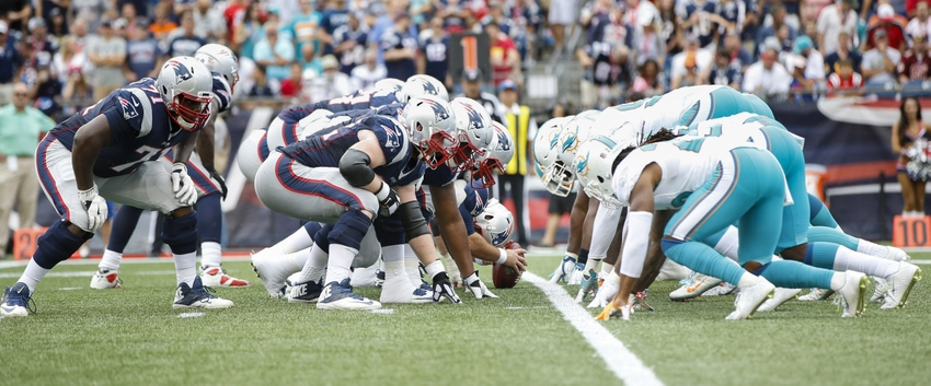 9550277-nfl-miami-dolphins-new-england-patriots
