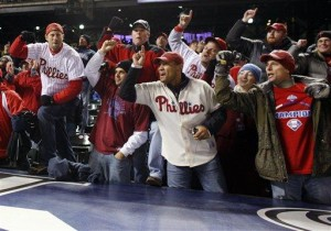 Philadelphia Phillies fans celebrate after the Phillies' 5-4 victory over the Colorado Rockies in Game 4 of the National League baseball division series Monday, Oct. 12, 2009, in Denver. The Phillies advanced to the National League Championship Series against the Los Angeles Dodgers. (AP Photo/David Zalubowski)