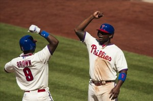 June 5, 2013; Philadelphia, PA, USA; Philadelphia Phillies left fielder Domonic Brown (9) celebrates hitting a two run home run with first baseman Ryan Howard (6) during the seventh inning against the Miami Marlins at Citizens Bank Park. The Phillies defeated the Marlins 6-1. Mandatory Credit: Howard Smith-USA TODAY Sports