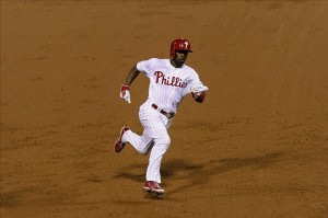 Even Jimmy Rollins can't help but be inspired by Tim Tebow. Image Credit: Howard Smith-USA TODAY Sports