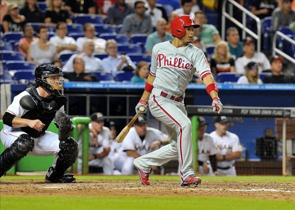 Sep 25, 2013; Miami, FL, USA; Philadelphia Phillies center fielder Cesar Hernandez (16) connects for an RBI single during the seventh inning against the Miami Marlins at Marlins Park. Mandatory Credit: Steve Mitchell-USA TODAY Sports