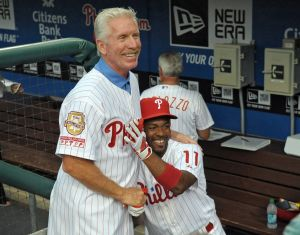 August 10, 2012; Philadelphia, PA USA; Philadelphia Phillies hall of fame third baseman Mike Schmidt jokes with Philadelphia Phillies shortstop Jimmy Rollins (11) during pre-game ceremony before game against the St. Louis Cardinals at Citizens Bank Park. Mandatory Credit: Eric Hartline-USA TODAY Sports