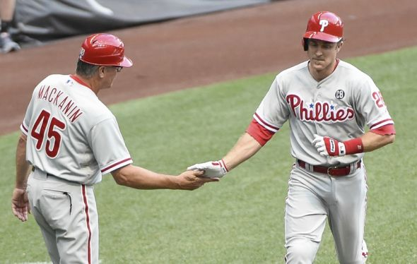Jul 7, 2014; Milwaukee, WI, USA; Philadelphia Phillies second baseman Chase Utley (26) is greeted by third base coach Pete Mackanin after hitting a two-run home run in the first inning against the Milwaukee Brewers at Miller Park. Mandatory Credit: Benny Sieu-USA TODAY Sports