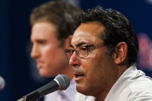 Aug 8, 2013; Philadelphia, PA, USA; Philadelphia Phillies general manager Ruben Amaro Jr announces a contract extension for second baseman Chase Utley (26) during a press conference after the game against the Chicago Cubs at Citizens Bank Park. The Phillies defeated the Cubs 12-1. Mandatory Credit: Howard Smith-USA TODAY Sports