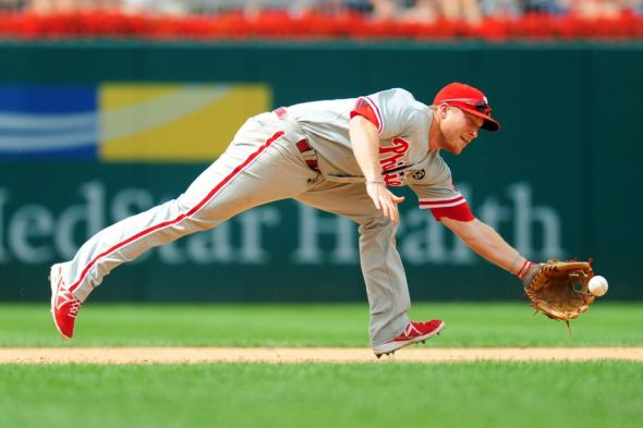 Aug 3, 2014; Washington, DC, USA; Philadelphia Phillies third baseman Cody Asche (25) reaches for a ground ball in the sixth inning against the Washington Nationals at Nationals Park. The Nationals won 4-0. Mandatory Credit: Evan Habeeb-USA TODAY Sports