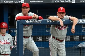 Jul 19, 2014; Atlanta, GA, USA; Philadelphia Phillies manager Ryne Sandberg (23) and bench coach Larry Bowa (10) (right) watch the action against the Atlanta Braves early in the game at Turner Field. The Phillies defeated the Braves 2-1. Mandatory Credit: Dale Zanine-USA TODAY Sports