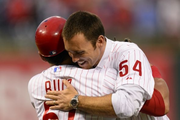Aug 1, 2013; Philadelphia, PA, USA; Brad Lidge the Philadelphia Phillies closer from the 2008 World Series hugs catcher Carlos Ruiz (51) after he threw out the first pitch prior to the game against the San Francisco Giants at Citizens Bank Park. Mandatory Credit: Howard Smith-USA TODAY Sports