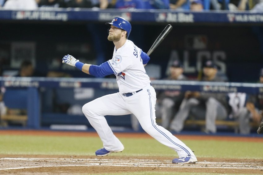 9615448-michael-saunders-mlb-alcs-cleveland-indians-toronto-blue-jays