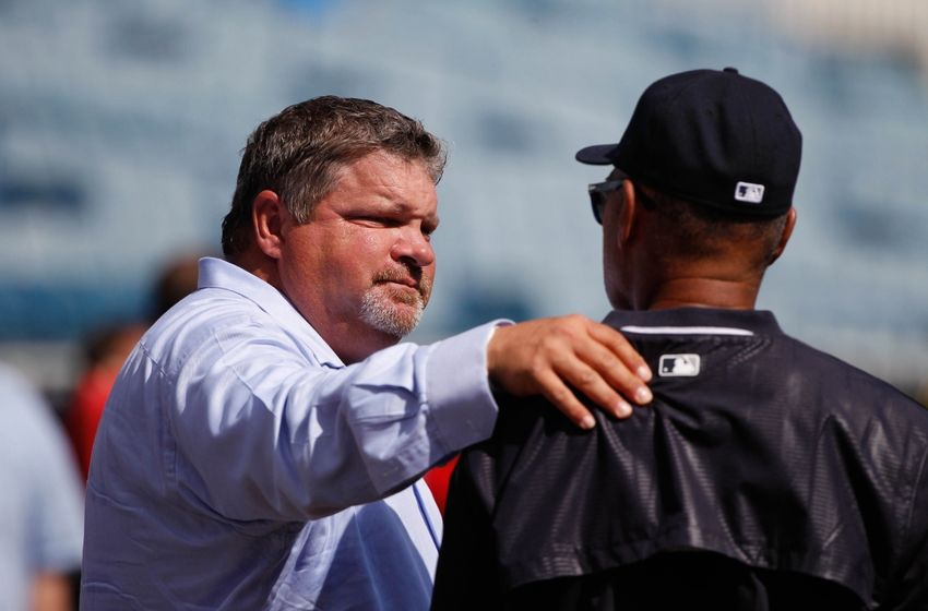 Mar 4, 2015; Tampa, FL, USA; ESPN baseball analyst John Kruk talks with New York Yankees guest instructor Reggie Jackson before a spring training baseball game against the Philadelphia Phillies at George M. Steinbrenner Field. Mandatory Credit: Kim Klement-USA TODAY Sports