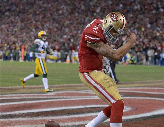 Jan 12, 2013; San Francisco, CA, USA; San Francisco 49ers quarterback Colin Kaepernick (7) celebrates after scoring on a 56-yard touchdown run against the Green Bay Packers in the NFC divisional round playoff game at Candlestick Park. Mandatory Credit: Kirby Lee-USA TODAY Sports