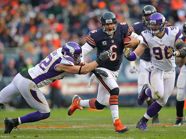 Nov 25, 2012; Chicago, IL, USA; Chicago Bears quarterback Jay Cutler (6) tries to evade Minnesota Vikings linebacker Chad Greenway (52) during the second half at Soldier Field. The Bears won 28-10. Mandatory Credit: Dennis Wierzbicki-USA TODAY Sports