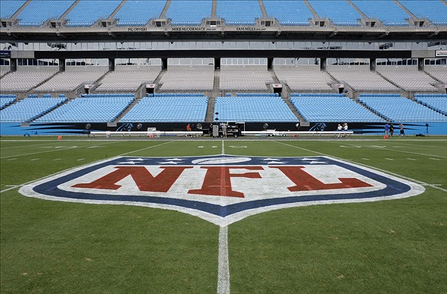 Aug 9, 2013; Charlotte, NC, USA; NFL shield logo on the 50 yard line before the game of the Carolina Panthers and the Chicago Bears at Bank of America Stadium. Mandatory Credit: Sam Sharpe-USA TODAY Sports