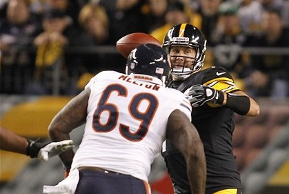 Sep 22, 2013; Pittsburgh, PA, USA; Pittsburgh Steelers quarterback Ben Roethlisberger (7) passes under pressure from Chicago Bears defensive tackle Henry Melton (69) during the second quarter at Heinz Field. Mandatory Credit: Charles LeClaire-USA TODAY Sports
