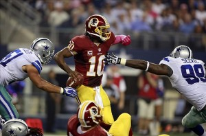 Oct 13, 2013; Arlington, TX, USA; Dallas Cowboys defensive end Kyle Wilber (51) and defensive end George Selvie (99) sack Washington Redskins quarterback Robert Griffin III (10) in the fourth quarter at AT