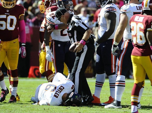Oct 20, 2013; Landover, MD, USA; Chicago Bears quarterback Jay Cutler (6) lays on the field with an apparent injury against the Washington Redskins during the first half at FedEX Field. Mandatory Credit: Brad Mills-USA TODAY Sports