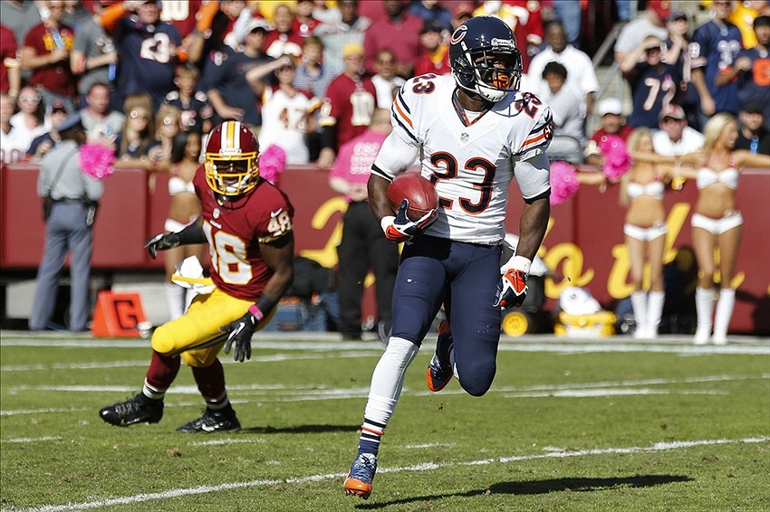 Oct 20, 2013; Landover, MD, USA; Chicago Bears wide receiver Devin Hester (23) runs with the ball past Washington Redskins defensive back Jose Gumbs (48) to make a touchdown in the second quarter at FedEx Field. Mandatory Credit: Geoff Burke-USA TODAY Sports