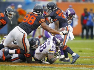 Sep 15, 2013; Chicago, IL, USA; Minnesota Vikings running back Adrian Peterson (28) fumbles after being hit by Chicago Bears defensive tackle Nate Collins (93) during the second half at Soldier Field. Chicago won 31-30. Mandatory Credit: Dennis Wierzbicki-USA TODAY Sports