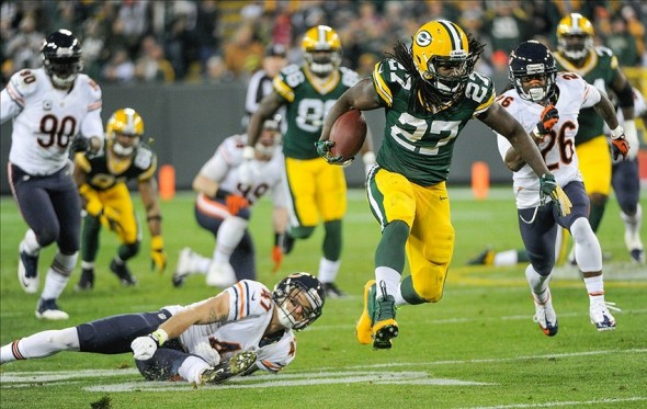 Nov 4, 2013; Green Bay, WI, USA; Green Bay Packers running back Eddie Lacy (27) breaks a tackle by Chicago Bears safety Chris Conte (47) for a 57-yard run in the 3rd quarter at Lambeau Field. Mandatory Credit: Benny Sieu-USA TODAY Sports