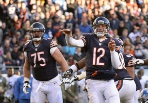 Nov 10, 2013; Chicago, IL, USA; Chicago Bears quarterback Josh McCown (12) throws a touchdown pass to Chicago Bears wide receiver Brandon Marshall (not pictured) during the second half at Soldier Field. Detroit defeats Chicago 21-19. Mandatory Credit: Mike DiNovo-USA TODAY Sports