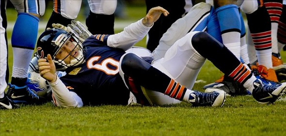 Nov 10, 2013; Chicago, IL, USA; Chicago Bears quarterback Jay Cutler (6) after he got pressured by Detroit Lions defensive tackle Nick Fairley (98) at Soldier Field. Mandatory Credit: Matt Marton-USA TODAY Sports