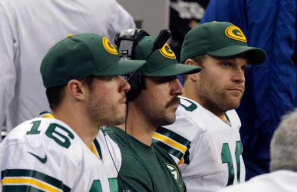 From left, Green Bay Packers' Scott Tolzien (16) sits with quarterback Aaron Rodgers, center, and Matt Flynn, right, on the bench during the second quarter of an NFL football game against the Detroit Lions at Ford Field in Detroit, Thursday, Nov. 28, 2013. Photo: Duane Burleson, AP