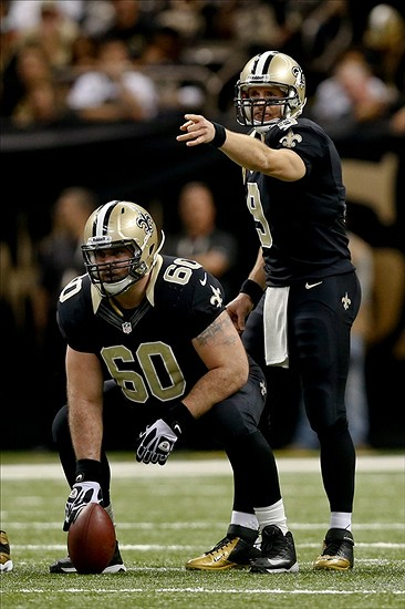 Nov 17, 2013; New Orleans, LA, USA; New Orleans Saints quarterback Drew Brees (9) under center Brian De La Puente (60) during the first half of a game against the San Francisco 49ers at Mercedes-Benz Superdome. Mandatory Credit: Derick E. Hingle-USA TODAY Sports