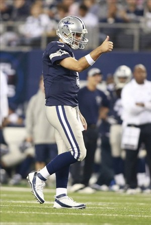 Nov 28, 2013; Arlington, TX, USA; Dallas Cowboys quarterback Tony Romo (9) reacts after a play against the Oakland Raiders during a NFL football game on Thanksgiving at AT