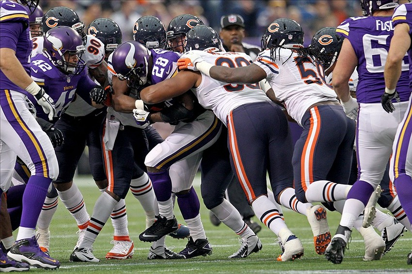 Dec 1, 2013; Minneapolis, MN, USA; Minnesota Vikings running back Adrian Peterson (28) is tackled by the Chicago Bears defense during the first quarter at Mall of America Field at H.H.H. Metrodome. Mandatory Credit: Brace Hemmelgarn-USA TODAY Sports