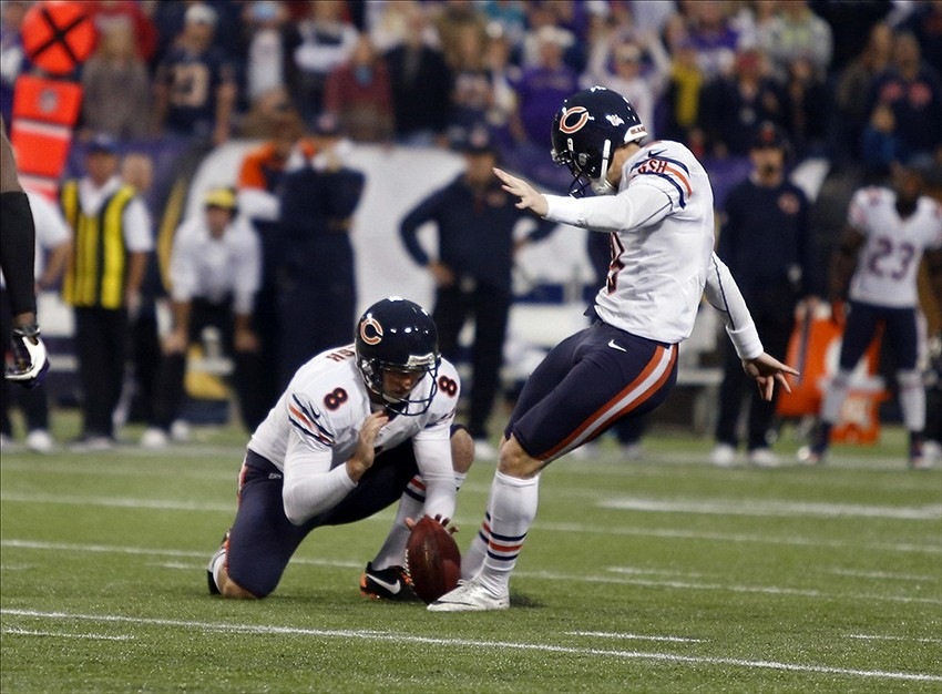 Dec 1, 2013; Minneapolis, MN, USA; Chicago Bears kicker Robbie Gould (9) attempts a 47 field goal as punter Adam Podlesh (8) holds but it misses right to keep the Minnesota Vikings still in play in overtime at Mall of America Field at H.H.H. Metrodome. Vikings win 23-20 in overtime. Mandatory Credit: Bruce Kluckhohn-USA TODAY Sports
