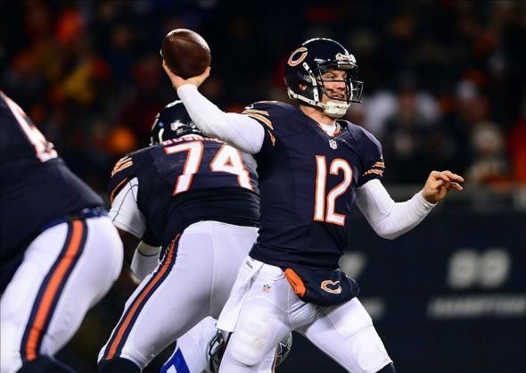 Dec 9, 2013; Chicago, IL, USA; Chicago Bears quarterback Josh McCown (12) throws a pass during the third quarter against the Dallas Cowboys at Soldier Field. Mandatory Credit: Andrew Weber-USA TODAY Sports