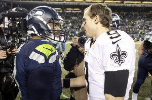 Dec 2, 2013; Seattle, WA, USA; New Orleans Saints quarterback Drew Brees (9) talks with Seattle Seahawks quarterback Russell Wilson (3) following a 34-7 Seattle victory at CenturyLink Field. Mandatory Credit: Joe Nicholson-USA TODAY Sports