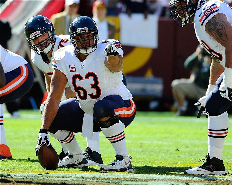 Oct 20, 2013; Landover, MD, USA; Chicago Bears center Roberto Garza (63) prepares to snap the ball against the Washington Redskins during the first half at FedEX Field. Mandatory Credit: Brad Mills-USA TODAY Sports