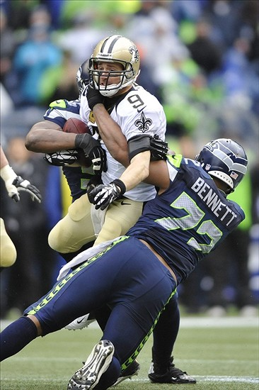 Jan 11, 2014; Seattle, WA, USA; Seattle Seahawks defensive end Michael Bennett (72) tackles New Orleans Saints quarterback Drew Brees (9) during the second half of the 2013 NFC divisional playoff football game at CenturyLink Field. Mandatory Credit: Steven Bisig-USA TODAY Sports