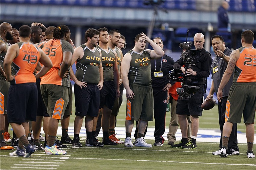 Feb 22, 2014; Indianapolis, IN, USA; Offensive lineman get instructions on drills during their workout during the 2014 NFL Combine at Lucas Oil Stadium. Mandatory Credit: Brian Spurlock-USA TODAY Sports
